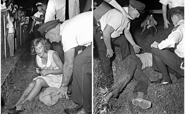 Beatles fans collapse on the ground from exhaustion during a concert in 1964.