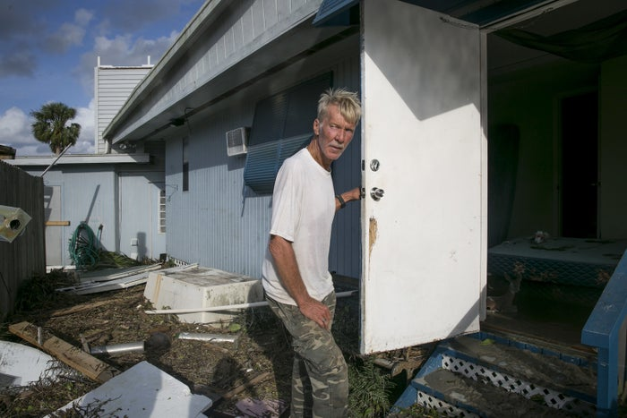 Kenny Crippen, 65, clears debris from his mobile homes in Plantation Island, Florida, south of Everglades City. More photos