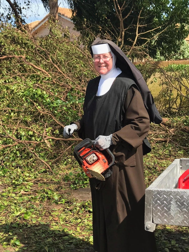This is Sister Margaret Ann of Archbishop Coleman F. Carroll High School in Miami, who casually grabbed a chainsaw from the school's closet and began clearing a fallen tree from a roadway.
