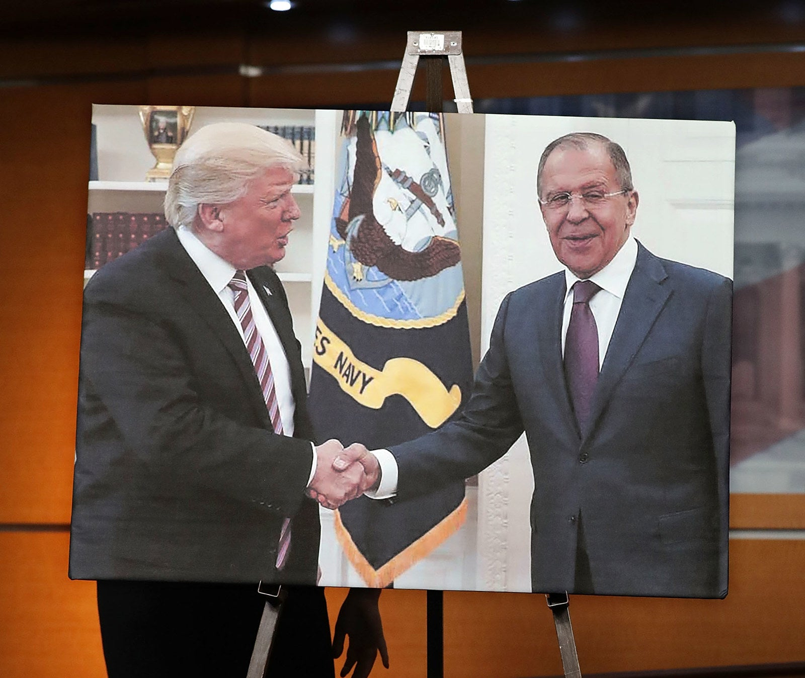 House Democrats displayed a photograph of President Donald Trump welcoming Russian Foreign Minister Sergey Lavrov at the White House during a news conference. The White House meeting came one day after Trump fired FBI director James Comey.
