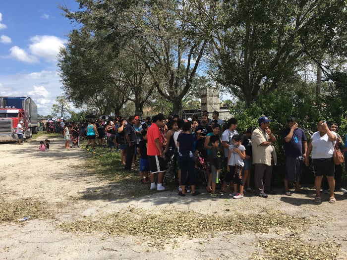 People line up for supplies after Hurricane Irma in Immokalee, Florida.