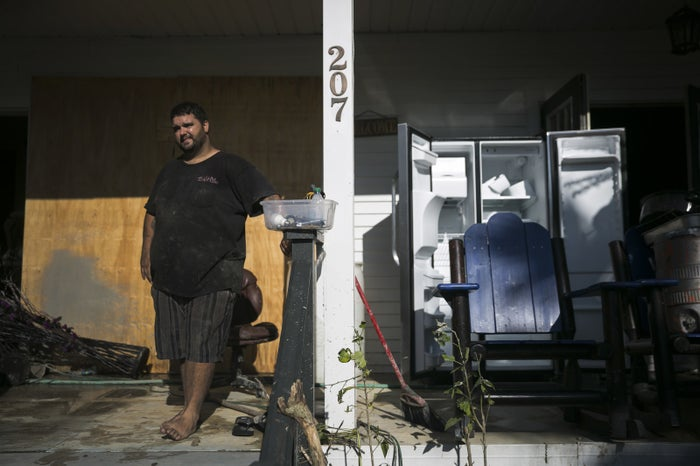 Fred Ayers, 33, a boat captain in Everglades City, returns to his home to clear out debris and water-damaged furniture.