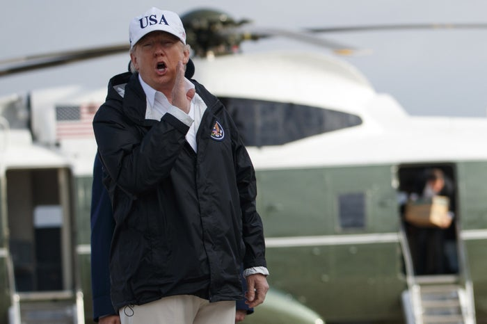 President Donald Trump responds to a reporters question as he boards Air Force One.