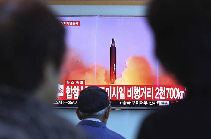 People watch file footage of North Korea's missile launch at the Seoul Railway Station on Aug. 29.