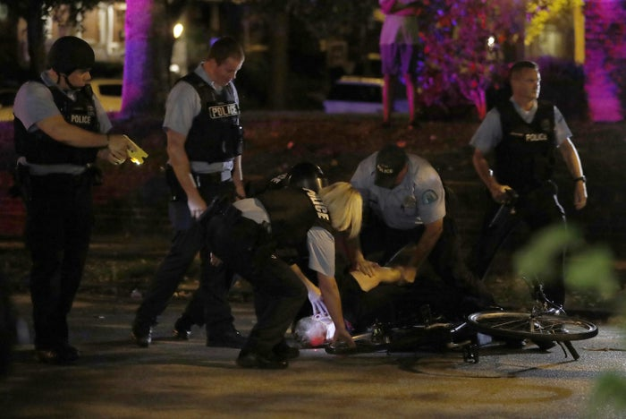 Police arrest a protester Friday night in St. Louis.