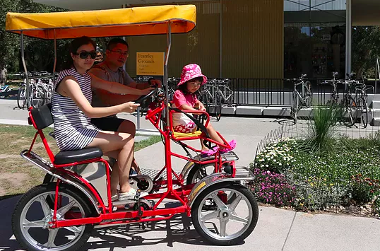 You can rent a two-seater pedal car for $40 an hour, which makes this a cheap and easy way to explore the park. There is a designated bike path to follow which means you'll have the best possible views of everything from the lakes to the wildlife.