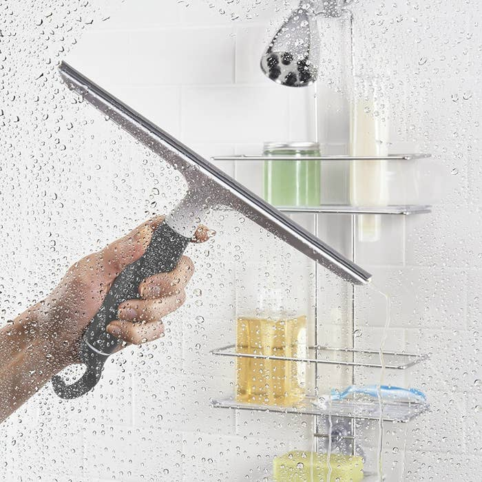 """Promising review: """"This squeegee works perfectly in our shower to clean our glass doors, as well as the shower walls themselves. The edge is nice and firm so it cleans on the first swipe. The handle is very comfortable too. This is probably the best shower squeegee we have ever bought and it seems like it will last a long while. We also like that we can hang it on the top of the shower spray pipe, to keep it out of the way."""" —Diane MCGet it from Amazon for $9.99 or Jet for $9.99."""