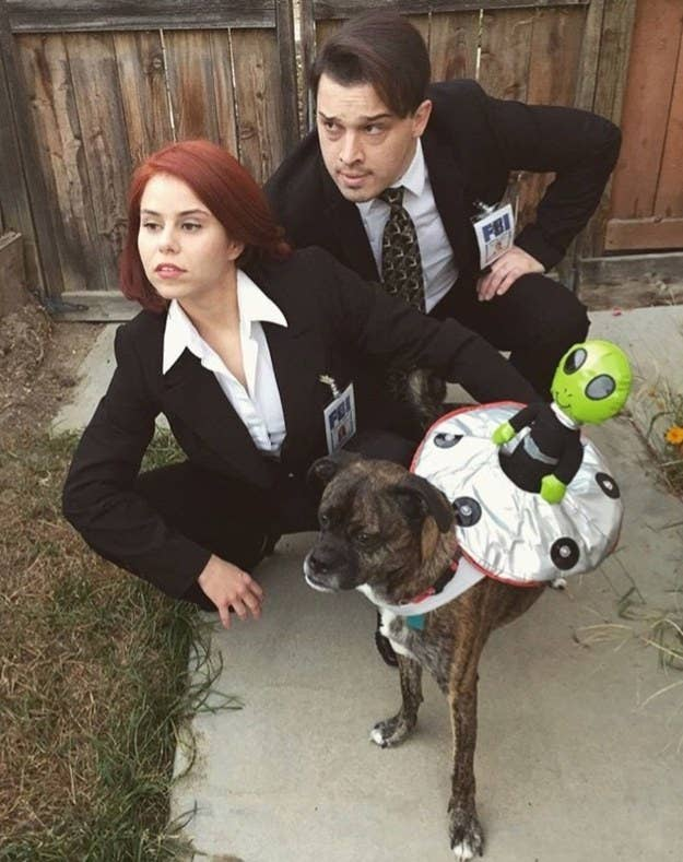 """""""A couple years back, my fiancé and I went as Scully and Mulder. All it took was a trip to the thrift store and an office supply store (for the badges).""""—jessicab44f8ce128"""