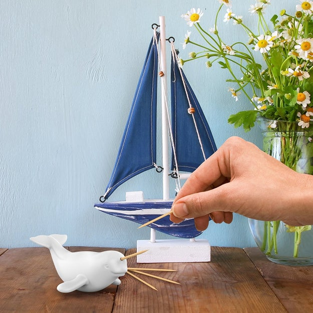 A narwhal toothpick dispenser to make getting a toothpick a gNARLY experience.