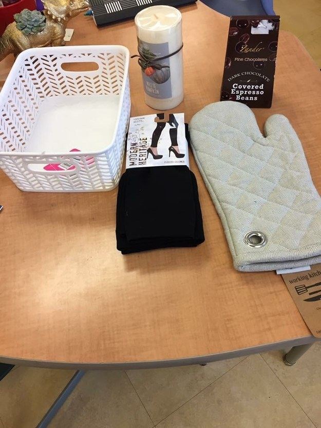 buzzfeed community member's gift basket with leggings, chocolate covered espresso beans, an oven mitt, and a candle