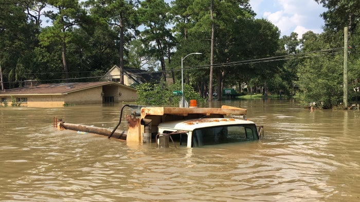 Water almost completely covers a truck in a residential neighborhood in west Houston on Sept. 1.