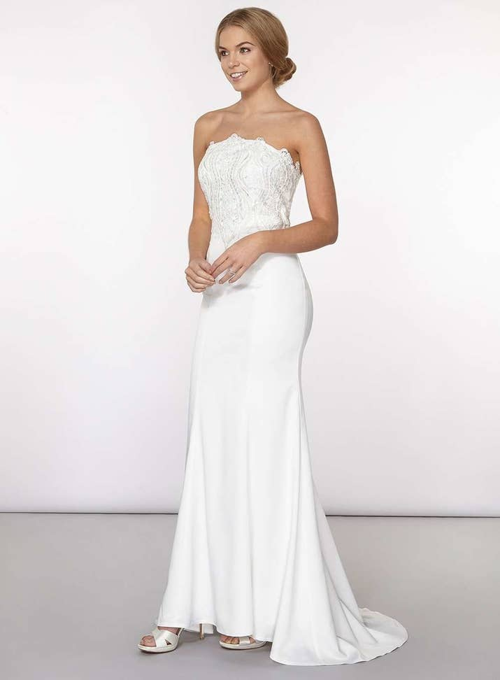 An Off White Strapless Gown With Delicate Beading From Dorothy Perkins GBP150