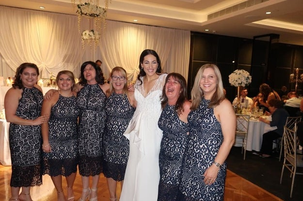 So hopefully these women were well-fed and tipsy when they realized they were all wearing the essentially the exact. same. dress. at bride Julia Mammone's September 16th wedding.