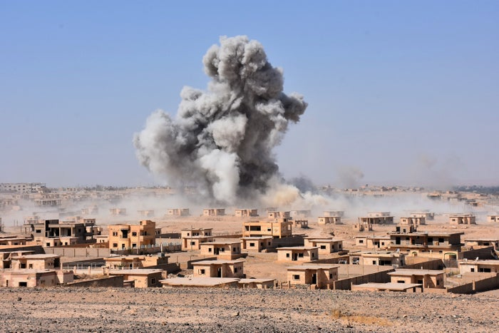 Smoke rises from buildings on the northern outskirts of Deir Ezzor as Syrian forces battle against ISIS.