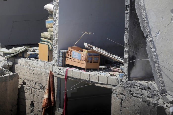 A baby bed inside a building damaged during fighting between the US-allied Syrian Democratic Forces and ISIS in Raqqa, Syria.