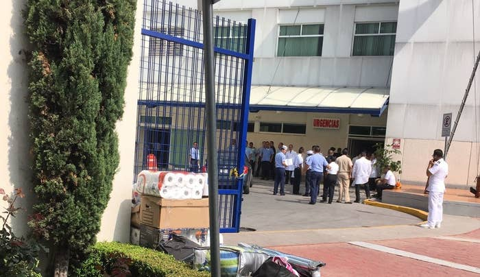 Doctors wait for emergency arrivals outside of the Hospital General Naval