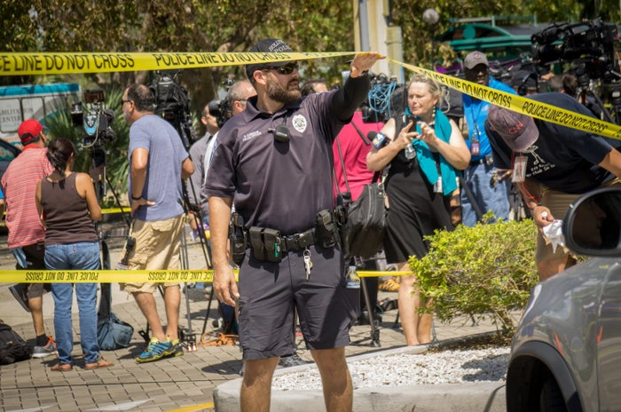 Police officers direct traffic outside a perimeter surrounding nursing home in Hollywood, Florida.