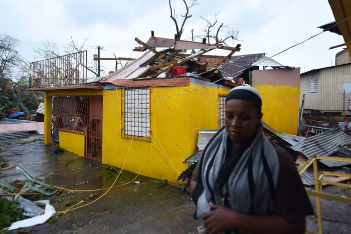 Residents of San Juan deal with damages to their homes after Hurricane Maria battered the island.