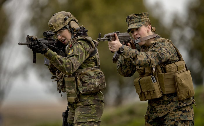 From left: A Romanian female soldier and a US Marines female counterpart aim after switching weapons to get used with each other's equipment during training on the Black Sea coast in Romania on March 20.