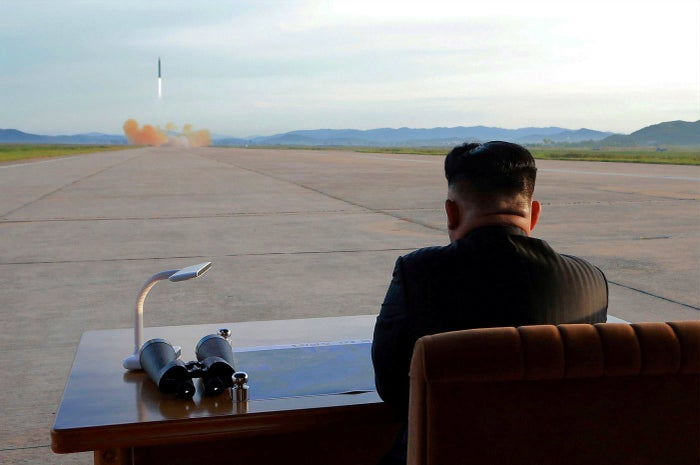 North Korean leader Kim Jong Un watches the launch of a Hwasong-12 missile in this undated photo released by North Korea's Korean Central News Agency on Sept. 16.