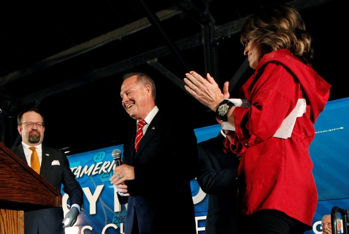 Ex-Trump adviser Sebastian Gorka (L) and former vice-presidential candidate Sarah Palin (R) campaign for U.S. Senate candidate Judge Roy Moore.