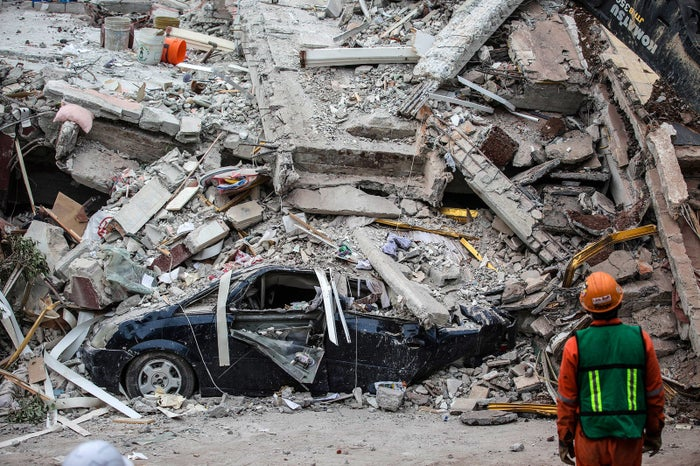 A rescue worker inspects the debris of a collapsed building on Sept. 21, following a magnitude 7.1 earthquake that struck Mexico City on Sept. 19.