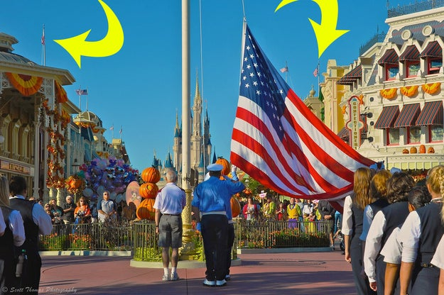 Besides the one atop the central flagpole, the American flags on Main Street USA aren't real American flags. That way, the park doesn't need to lower or light them at night.