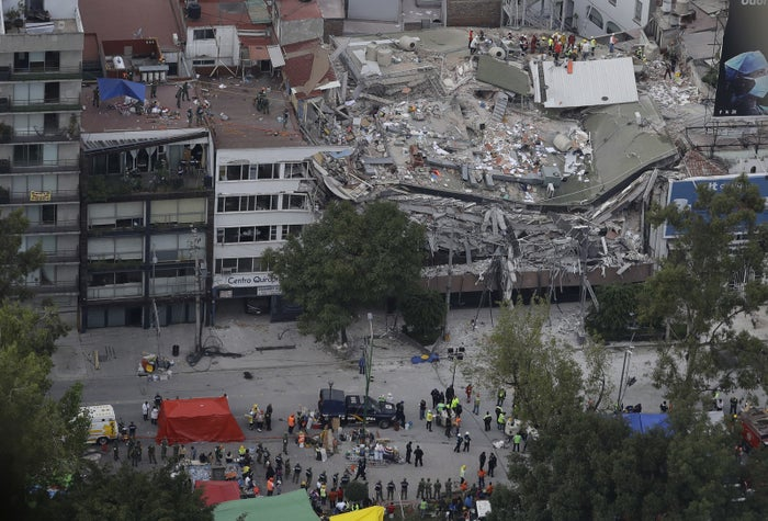 Rescue workers search for people trapped inside a collapsed building in the Roma Norte neighborhood of Mexico City.