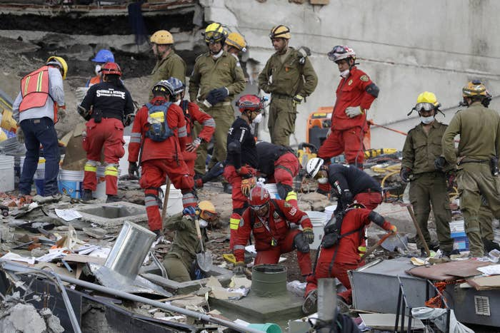 Mexican and Israeli specialists work at the site of a building felled by the 7.1-magnitude earthquake.