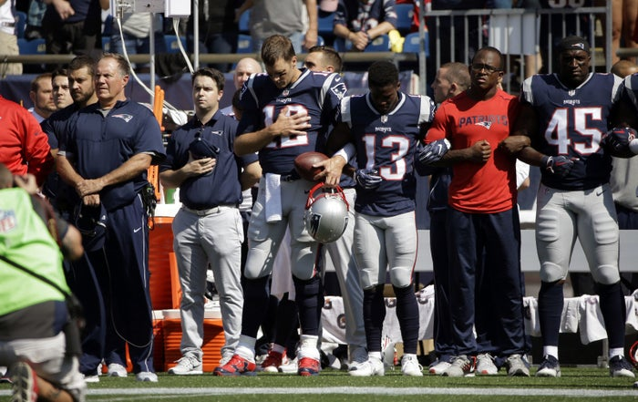 Brady appeared to link one arm with wide receiver Phillip Dorsett at the end of a line of players.