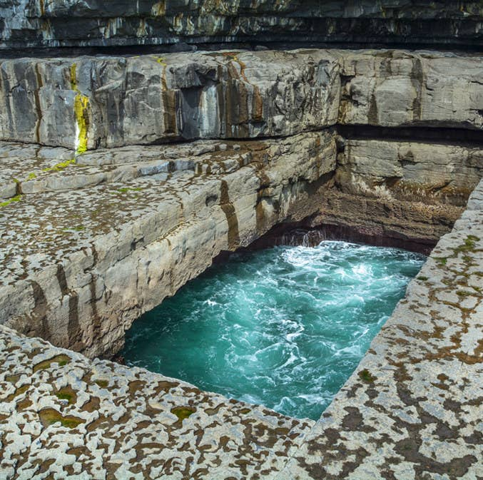 Also known as the Worm Hole, this naturally formed pool is situated on Inis Mór island off the west coast of Ireland. It's a popular spot for cliff jumpers, but if you'd prefer to stay dry, we won't blame you. It's still stunning to observe from a distance.