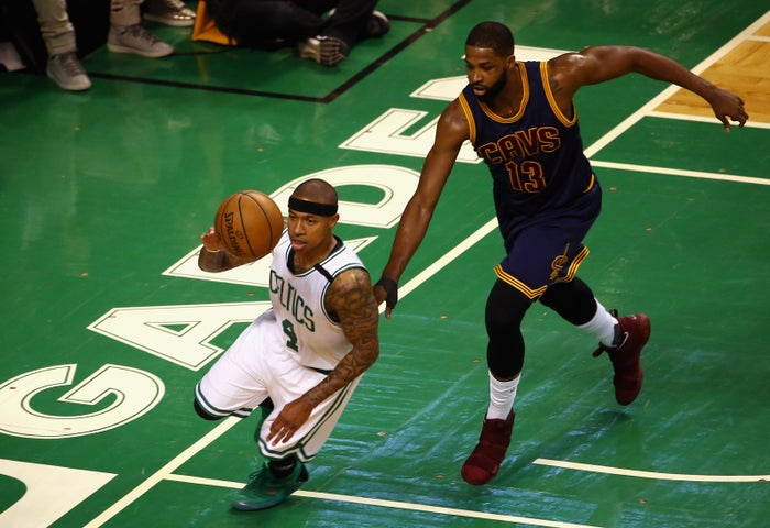 Isaiah Thomas #4 of the Boston Celtics dribbles the ball against Tristan Thompson #13 of the Cleveland Cavaliers.