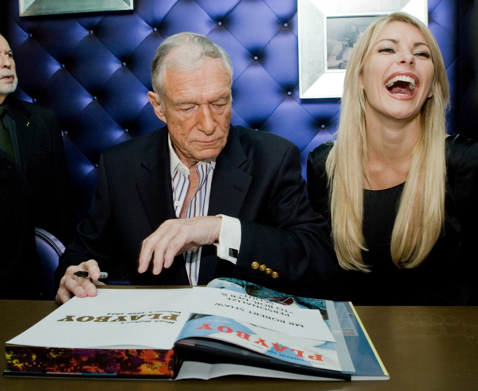 Hefner and model Crystal Harris, later Crystal Hefner, attend a signing in Los Angeles on Dec. 10, 2009.