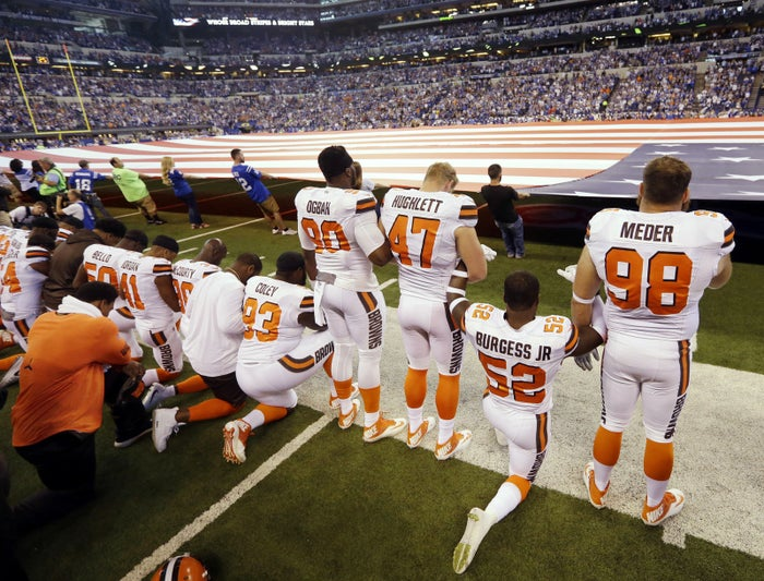 Cleveland Browns take a knee during the national anthem on Sept. 24.