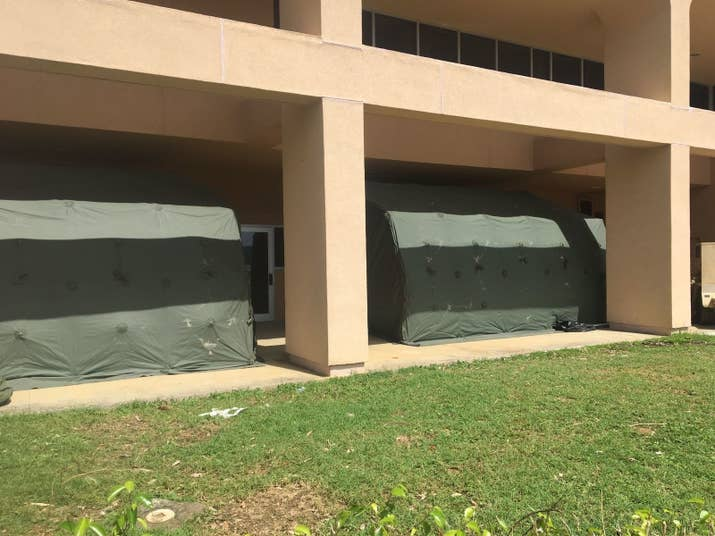 Army tents awaiting patients outside Schneider Regional