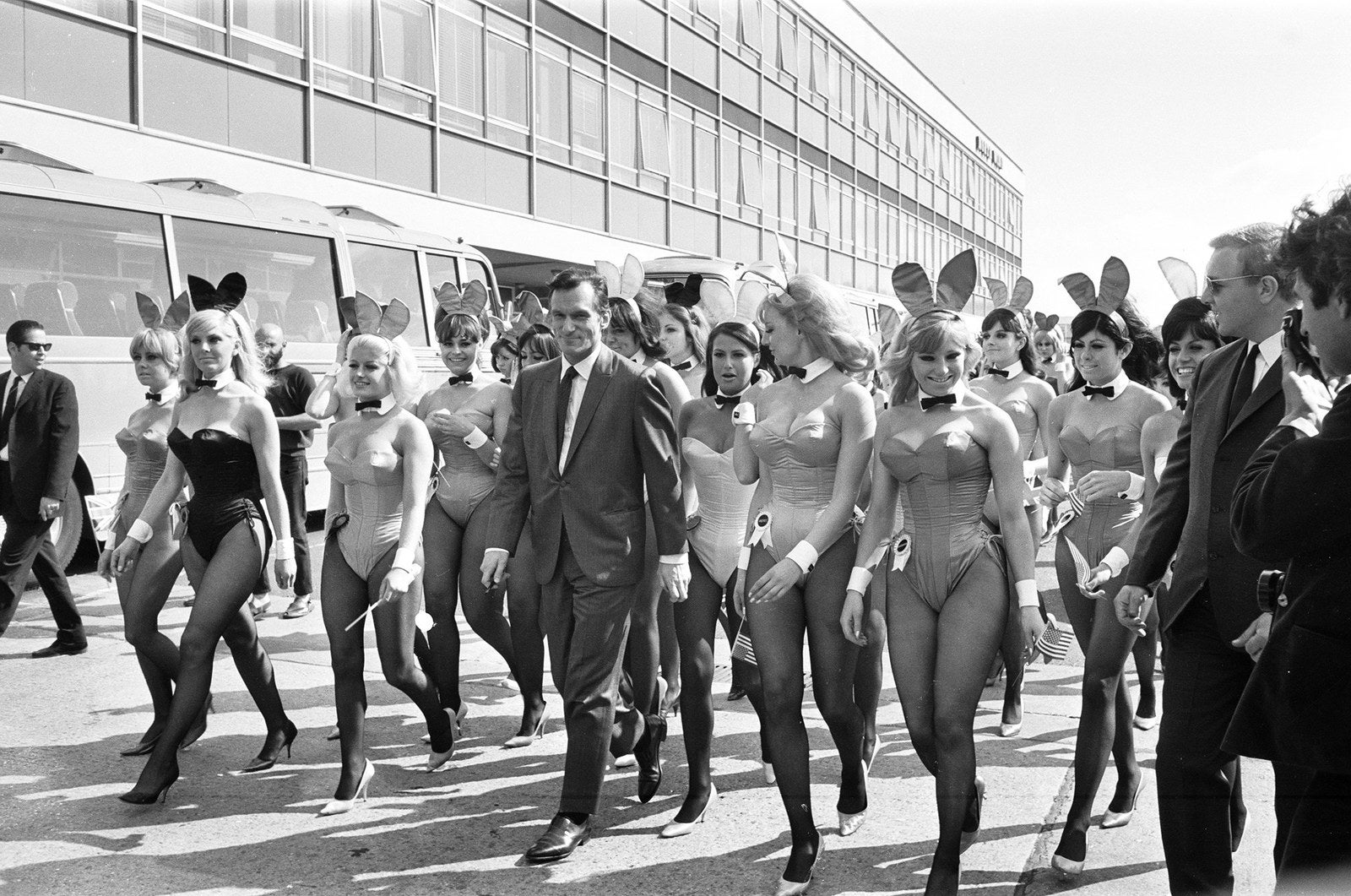 Hefner arrives with an entourage of Bunnies at London Heathrow Airport on June 25, 1966. During this trip to Britain, he opened his 16th Playboy Club, located in Park Lane, London.