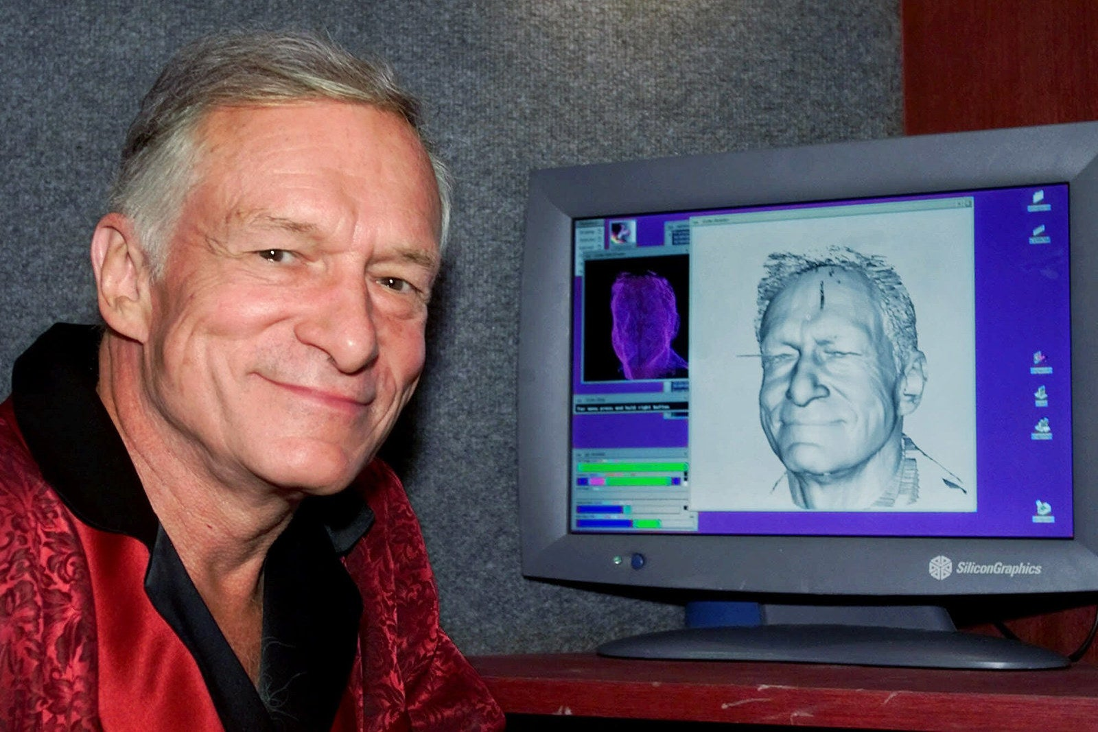 Hefner poses next to a laser-generated image of his head on a computer screen following a laser scanning session on Sept. 26, 2000, at the Playboy Mansion in Los Angeles. The resulting image was used to create an exact wax model of his head for a figure at the Hollywood Wax Museum.