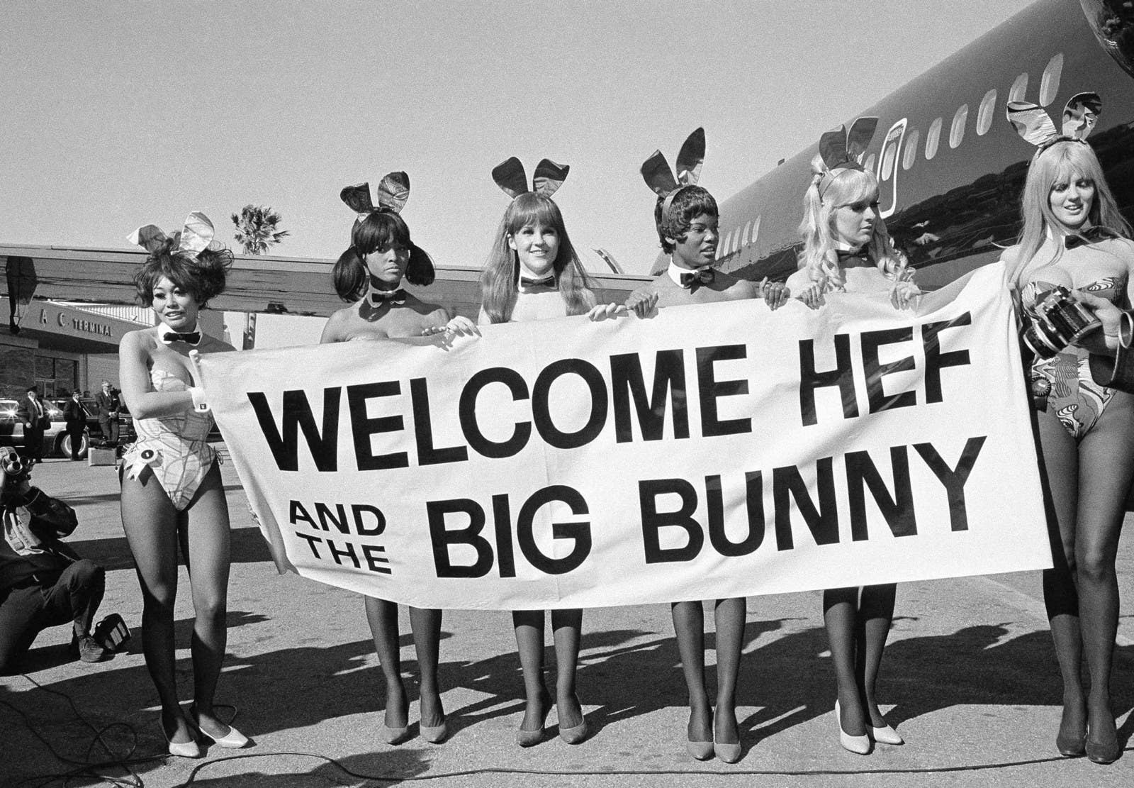 Playboy Bunnies welcome Hugh Hefner on the inaugural flight of his new DC-9 jetliner, The Big Bunny, on March 17, 1970.
