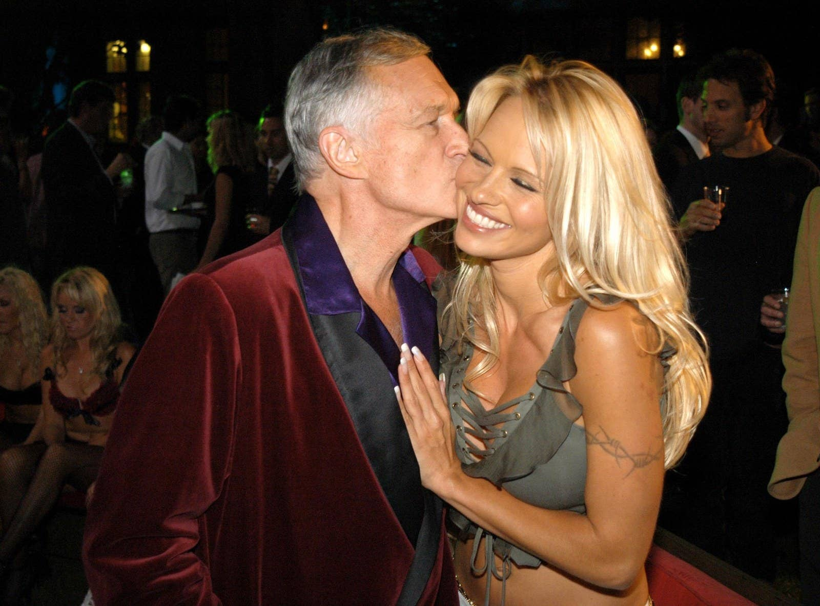 Hugh Hefner shares a moment with Pamela Anderson during the launch party for Spike TV at The Playboy Mansion in 2003.