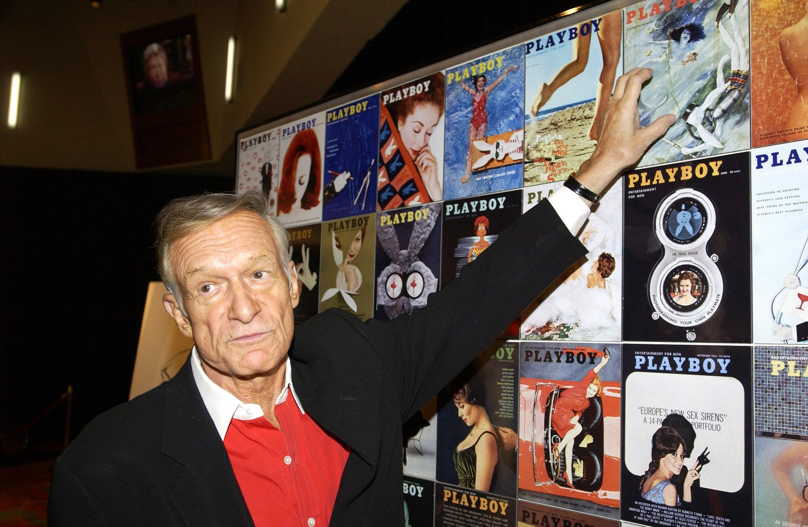 Hefner looks at past Playboy covers during a Las Vegas party celebrating Playboy's 50th anniversary in 2009.