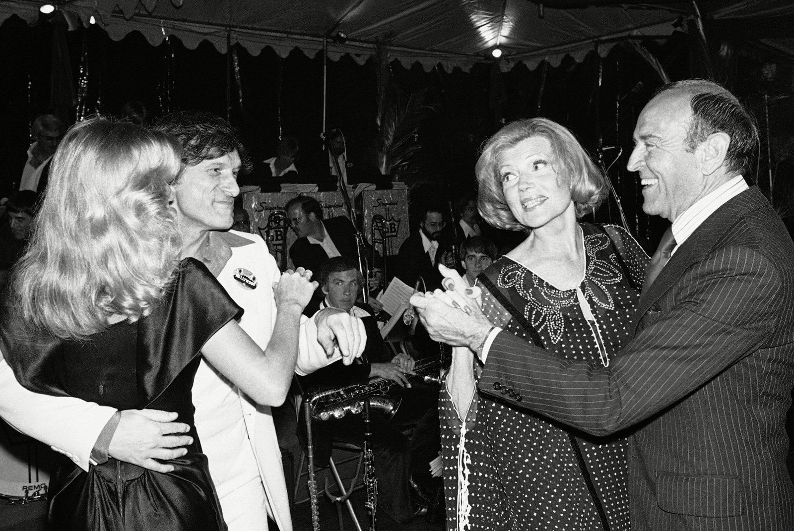 Hefner dances with playmate Sandra Theodore, alongside actress Rita Hayworth and her former choreographer Hermes Pan, during a fundraising party to save the Hollywood sign in Los Angeles in 1978.