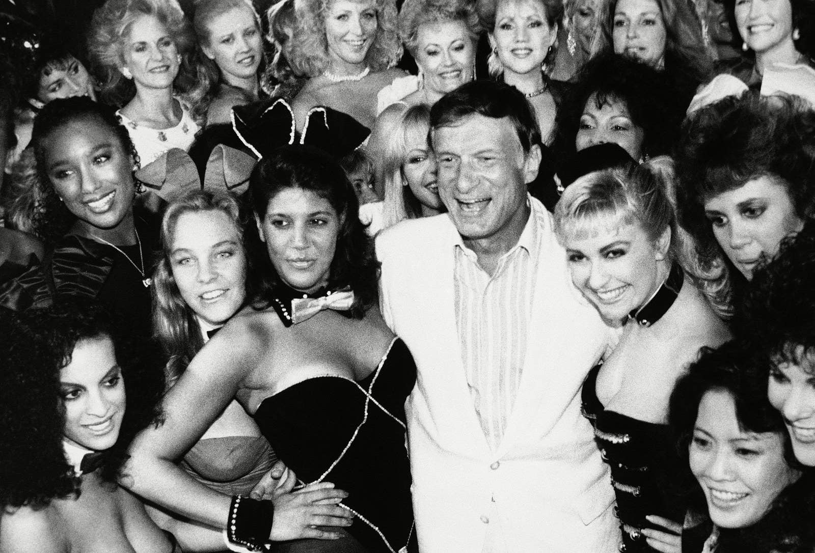 Hefner poses with a group of current and former Playboy Bunnies at the Los Angeles Playboy Club in 1986.