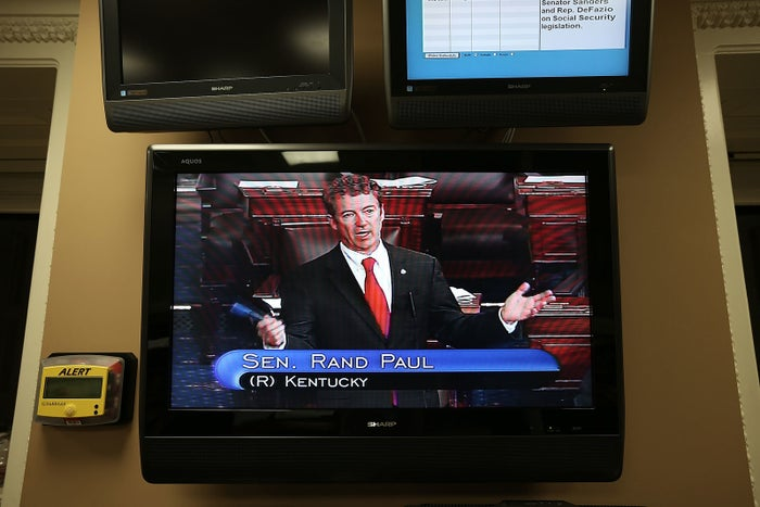 U.S. Sen. Rand Paul (R-KY) is seen on a TV monitor as he participates in a filibuster on the Senate floor March 6, 2013 on Capitol Hill in Washington, DC.