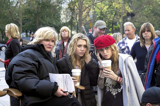 OK, chill. It's just Ashley and Mary-Kate Olsen casually working their magic on the set of New York Minute. They're probably trying to figure out how to slip Roxy's demo tape to Simple Plan.