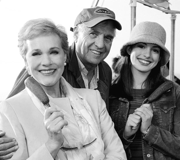 And here's Anne Hathaway wearing a truly amazing bucket hat on the set of the one and only Princess Diaries, alongside Julie Andrews and director Garry Marshall.
