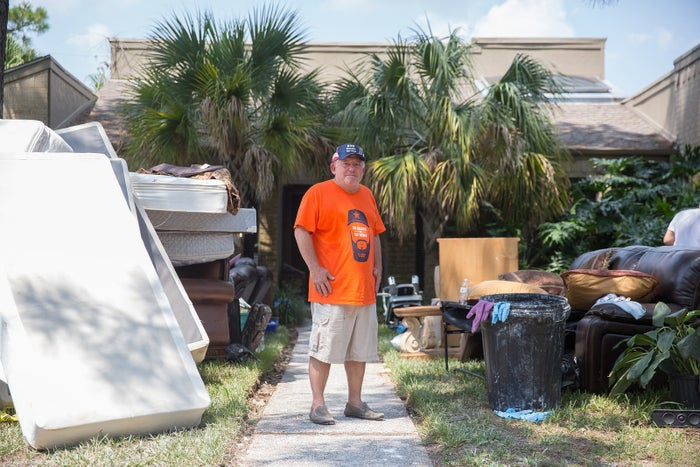Dan Faust in front of his damaged home in Dickinson, TX.