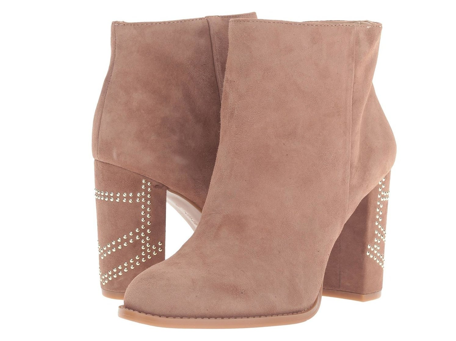 A pair of suede booties with a decorated block heel for extra coolness.