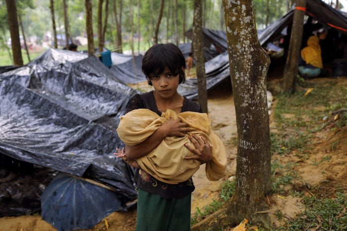 A Rohingya refugee from Myanmar's Rakhine state holds a baby at a camp in Bangladesh.