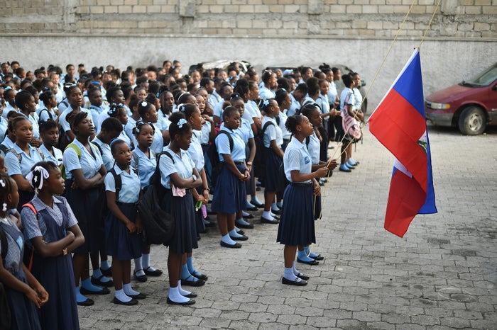 Students prepare for the first day of school at the Lycée Du Cent Cinquantenaire in Port-au-Prince, Haiti, on Sept. 4.