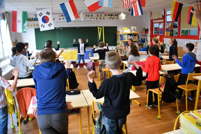 Pupils stand in a classroom on the first day of school at the La Courbe primary school in Aytré, France, on Sept. 4.